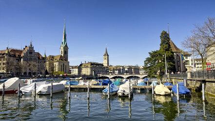 Switzerland, Zurich, View to Limmat river with mooring area, Frauenmuenster Post, St. Peter's Church - KRPF001525