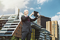 Germany, Berlin, Potsdam Square, business man with digital tablet - TAM000252