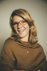 Portrait of smiling blond woman wearing glasses - MFF001680