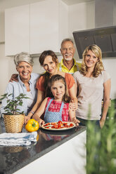 Group picture of three generations family in the kitchen - MFF001739