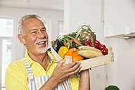 Portrait of man holding wooden box of vegetables - MFF001755