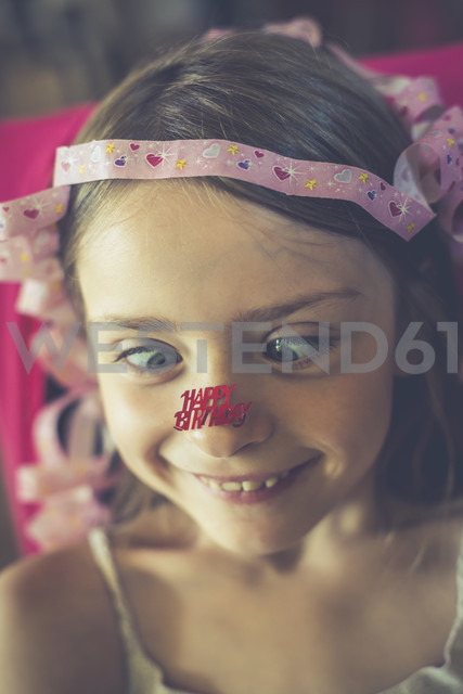Portrait of little girl with 'Happy gluing Birthday' at her nose - SARF002025