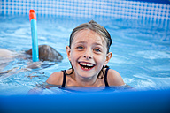 Portrait of laughing little girl in a swimming pool - SARF002029