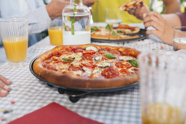 Homemade pizza on a table - MFF001709