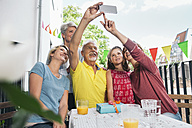 Three generations family taking a selfie on balcony - MFF001715