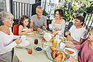 Family having breakfast on balcony - MFF001731