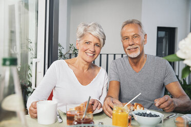 Elderly couple having breakfast at balcony - MFF001734