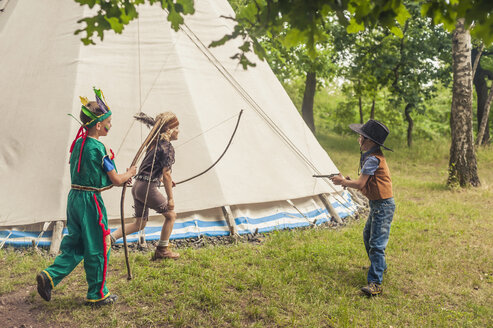 Germany, Saxony, Indians and cowboy party, Boys playing with bow and arrow - MJF001643