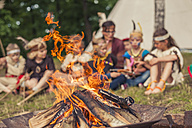 Germany, Saxony, Indians and cowboy party, Children sitting at bonfire - MJF001656