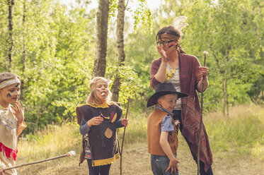 Germany, Saxony, Indians and cowboy party, Children rasting marshmallows on sticks - MJF001659