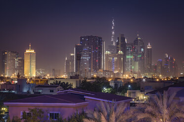 United Arab Emirates, Dubai, view of Downtown Dubai skyline with Burj Khalifa at night - NKF000279