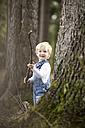 Little boy with branch in the woods - MFRF000233