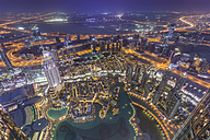 United Arab Emirates, Dubai, aerial view from the Burj Khalifa over Burj Khalifa Lake, Souk Al Bahar and the Dubai Creek at night - NKF000265