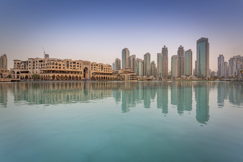 United Arab Emirates, Dubai, Burj Khalifa Lake and Souk Al Bahar in the evening - NKF000271