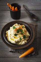 Bowl of Hummus and carrots - EVGF002181