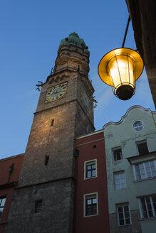 Austria, Tyrol, Innsbruck, town tower in the evening - MKFF000234