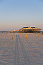 Germany, St Peter-Ording, pile dwelling on the beach by backlight - MEMF000838
