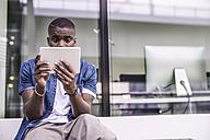 Young man using digital tablet - RIBF000133