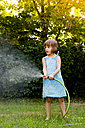 Little girl with garden hose - LVF003677