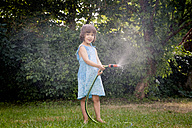 Little girl with garden hose - LVF003679
