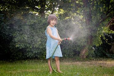 Little girl with garden hose - LVF003679