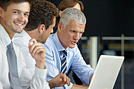Businesspeople working on laptop - CHAF000374
