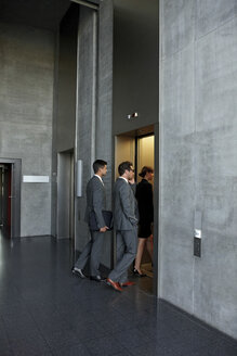 Group of businesspeople entering the elevator in office - CHAF000400