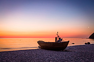 Germany, Ruegen, Binz, boat on beach at sunrise - PUF000382