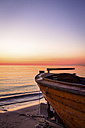 Germany, Ruegen, Binz, boat on beach at sunrise - PUF000373
