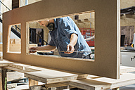 Carpenter measuring piece of wood in workshop - JUBF000020