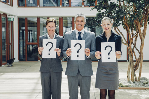 Business people with question mark on placards - CHAF000500