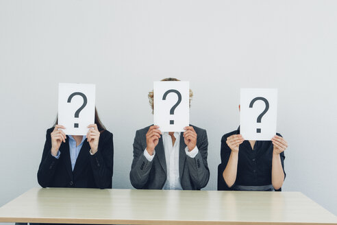 Business people with question mark on placards - CHAF000517
