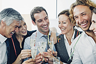 Group of business people raising a toast with champagne at office - CHAF000519