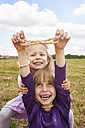 Two little girls with necklace and bracelet made of Hundreds and Thousands - STKF001316