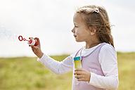 Little children girl blowing soap bubbles - STKF001331