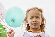 Portrait of little girl with balloons - STKF001352