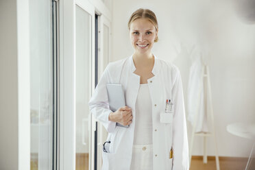 Portrait of smiling female doctor with digital tablet - MFF001829