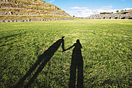 Peru, Cusco, shadow of two travelers visiting Saksaywaman citadel - GEMF000281