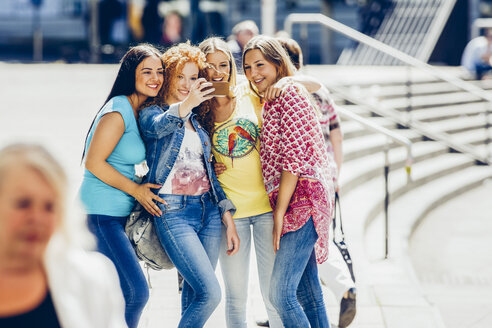 Group of four female friends taking a selfie with smartphone - CHAF000781