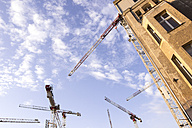 Germany, Berlin, cranes at construction site - CMF000286
