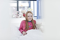 Portrait of girl with red hair in hospital bed - ZEF006010