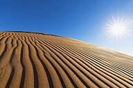 Africa, Namibia, Namib Desert, Namib-Naukluft National Park, desert dune against the sun - FOF008155