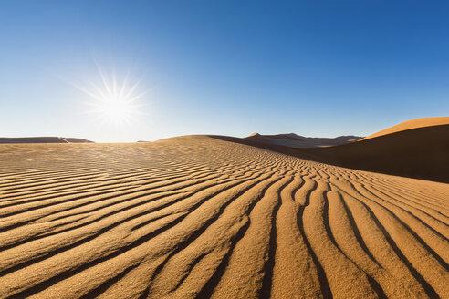 Africa, Namibia, Namib Desert, Namib-Naukluft National Park, desert dune against the sun - FOF008158