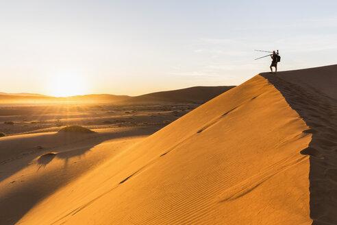 Namibia, Namib Desert, Namib Naukluft National Park, photographer standing on dersert dune - FOF008174