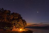 Zimbabwe, Urungwe District, Mana Pools National Park, camp fire at riverside of Zambezi at night - FOF008247