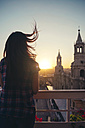 Peru, Arequipa, woman looking at Plaza de Armas enjoying sunset - GEMF000285