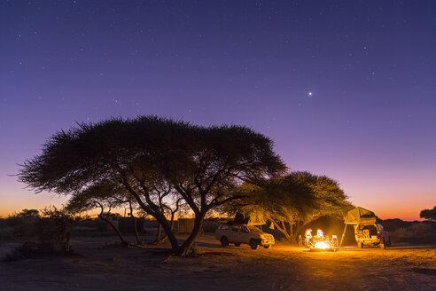 Botswana, Kalahari, Central Kalahari Game Reserve, campsite with campfire under starry sky - FOF008271