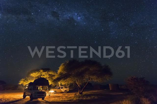Botswana, Kalahari, Central Kalahari Game Reserve, campsite with campfire under starry sky - FOF008273