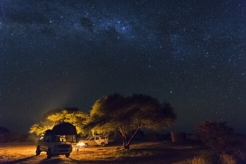 Botswana, Kalahari, Central Kalahari Game Reserve, campsite with campfire under starry sky - FOF008273