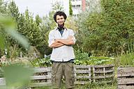 Young man standing in an urban garden - SGF001765
